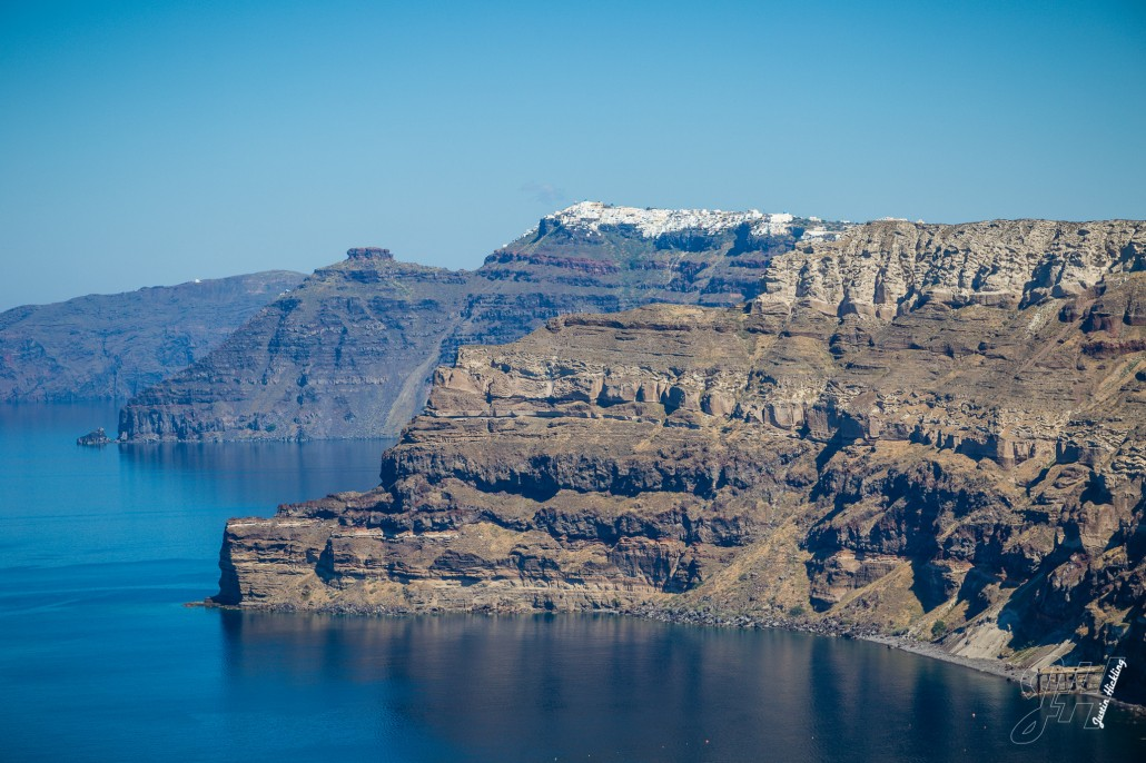 Cliffs and Thira in the background.